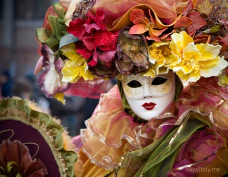 Masked flower woman in Venice