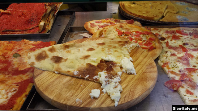 Focaccia with melted Stracchino cheese. Photo © Slow Italy.