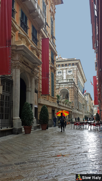 Via Garibaldi on a rainy day. Photo © Slow Italy